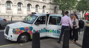 The Healthwatch Essex Chatterbox cab's passengers prepare to disembark outside Richmond House