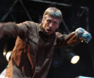 Bez out of Happy Mondays shakes his maracas on stage