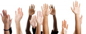 Multiple open palmed hands reaching upwards against a white background