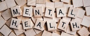 The words 'mental health' illustrated as scrabble letters