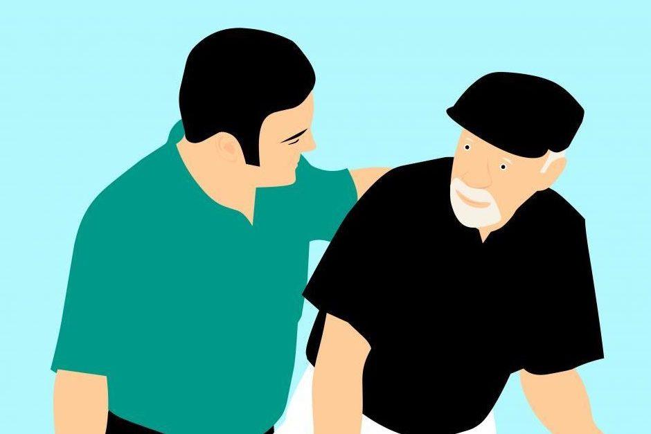 Care worker in conversation with elderly man