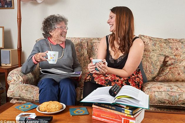 Elderly lady Florence enjoys a cup of tea on the sofa with Homeshare companion Alexandra