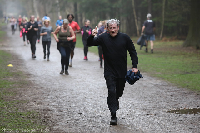 Older man on a park run with other runners