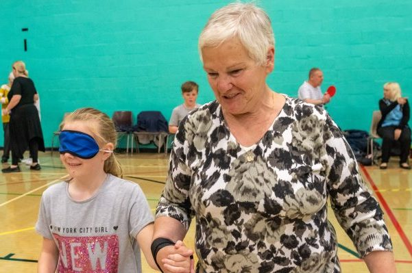Grandaughter and grandmother playing games in sports hall