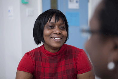 Social care manager smiling in conversation