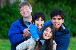 Family with children with disability having fun