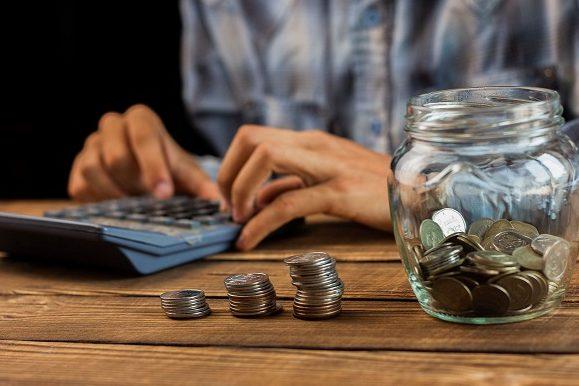 man calculating savings