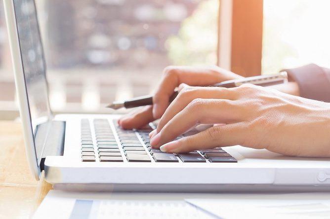 hands on computer laptop