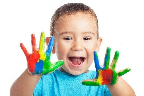 Happy kid with paint covered hands