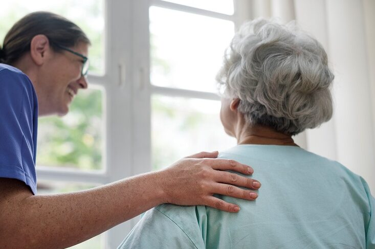 Care colleague smiling at resident