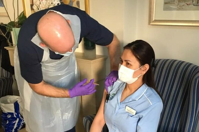 Care home colleague being vaccinated