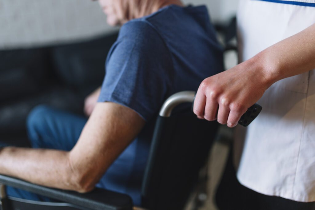 Man in wheelchair in a care home