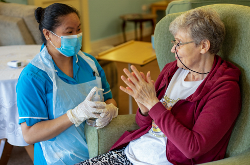 Care colleague talking to resident